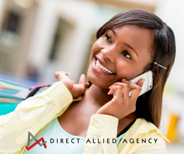 A beautiful woman conducting phone services with a big smile talking on a mobile phone