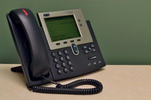 A desk phone with a blinking red light
